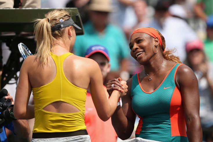 Serena Williams shakes hands at the net after her straight sets victory against Maria Sharapova during their semi final round match at the Sony Open on March 27, 2014 in Key Biscayne, Florida. (Source: Clive Brunskill/Getty Images North America)