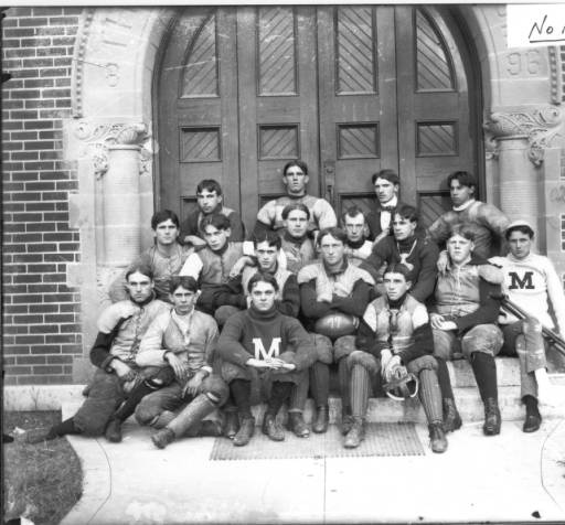 This photograph from 1899 is one of the earliest extant images of a Miami University football team. The players, many of whom were enrolled in the preparatory department of the university, posed in front of the school's gymnasium in Oxford, Ohio.