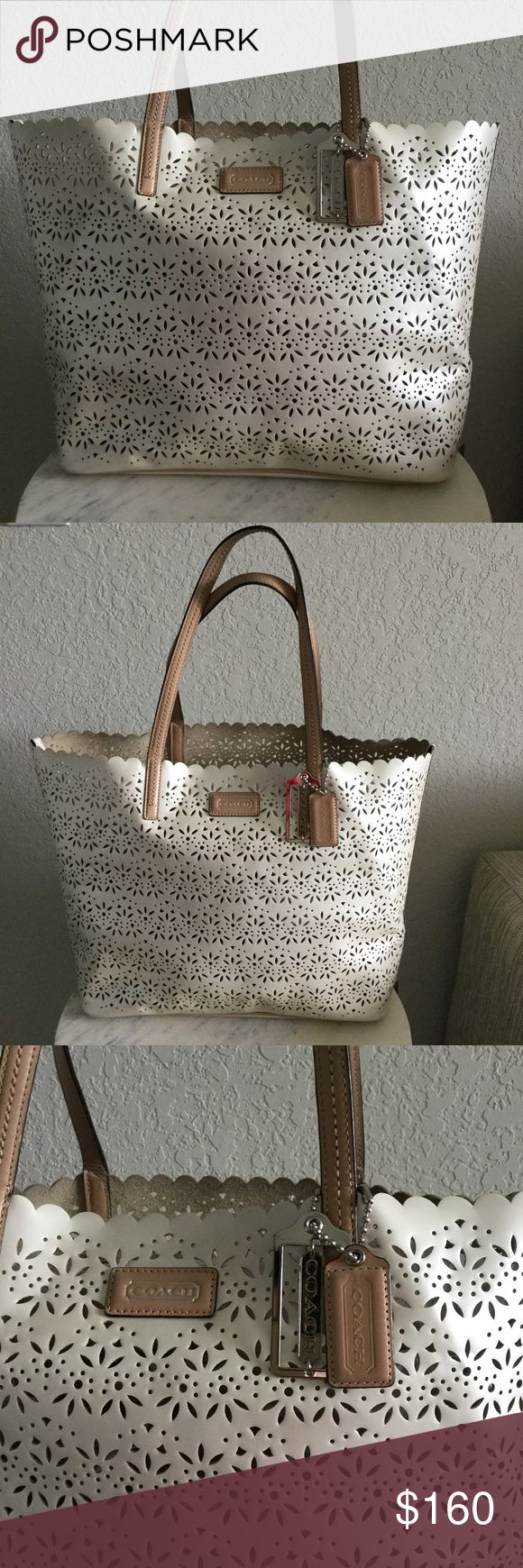 """Coach Laser Cut Floral Gold Brown Beige Tote Excellent condition. Some minor scuffing on the handles. See picture. Some minor staining on the inside bottom. Overall excellent condition. Measures: 19"""" (L) x 4"""" (W) x 12"""" (H) Strap drop: 8"""" Coach Bags Totes"""