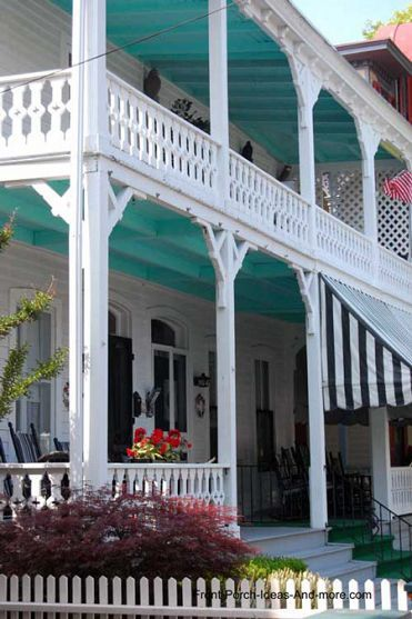 Two-story porch with blue ceilings.