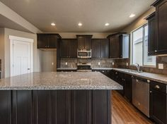 The Sweetwater on Samoa Dune Drive Paint, New Caledonia granite, espresso cabinets