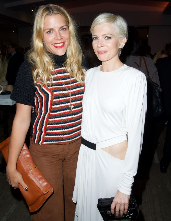 SQUAD GOALS    Busy Phillips gives her best friend Michelle Williams some support at the Beverly Hills premiere of Manchester By the Sea on Monday. Star Tracks: Tuesday, November 15, 2016