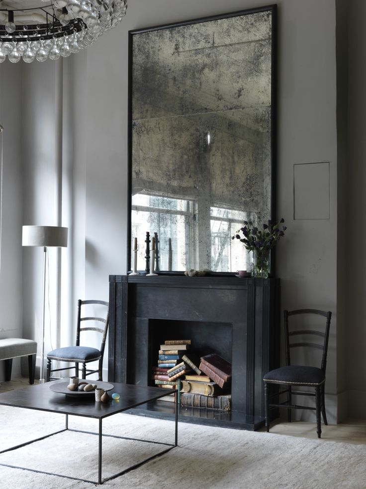 Modern coffee table / antique mirror over fireplace /designer Erin Swift