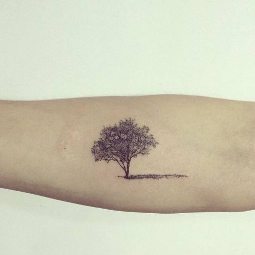 Forearm tattoo of a tree. Tattoo artist: Hongdam