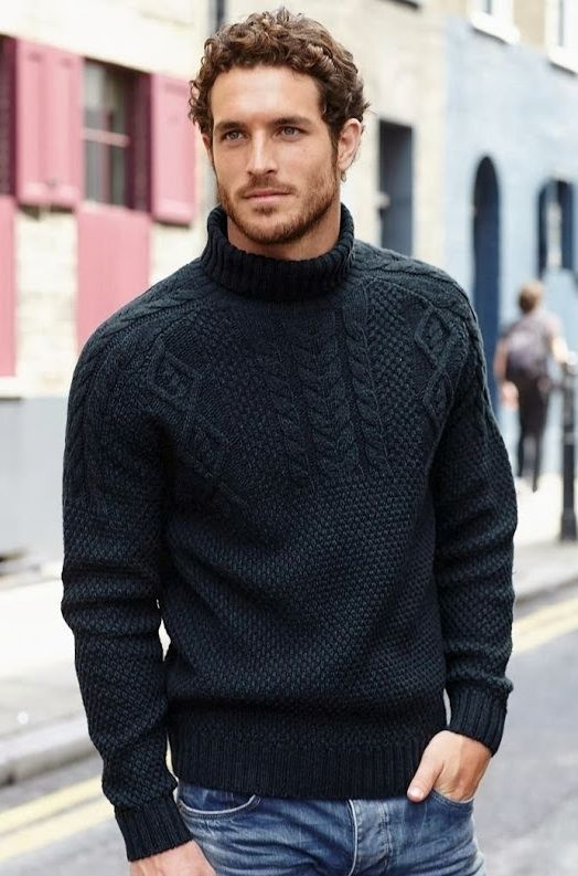 Hand knit man's sweater in black...