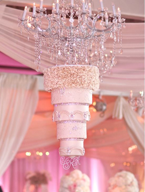 Incredible suspended chandelier wedding cake. Upside down cakes! || Aisle Perfect