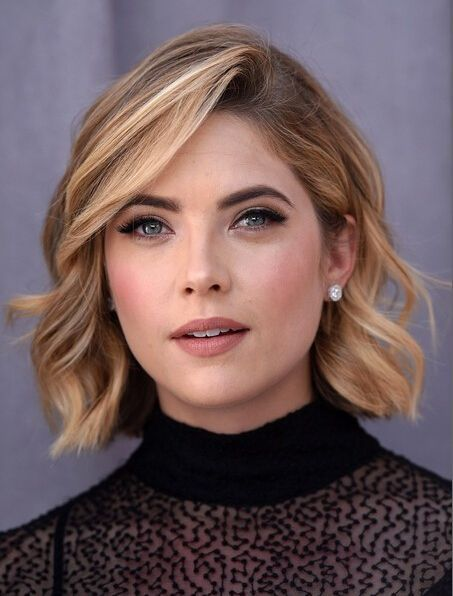 Short hairstyle idea. I like the deep side part and how her hair has a little wave to it.
