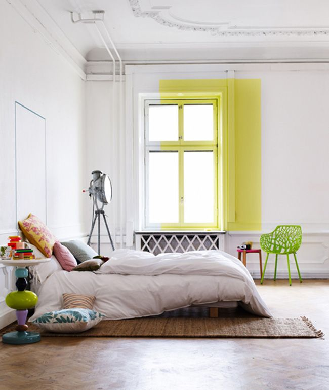 low bed bedroom with a pop of yellow