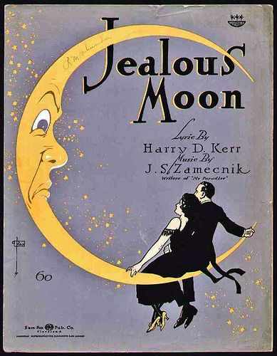 Jealous Moon, 1920s [centerpiece/framed]. (My sister had a 20's themed birthday party, and all she did was print off papers like these, frame them, and glued a peacock feather and fake diamond to it. Cheap, simple, and you can get creative!]