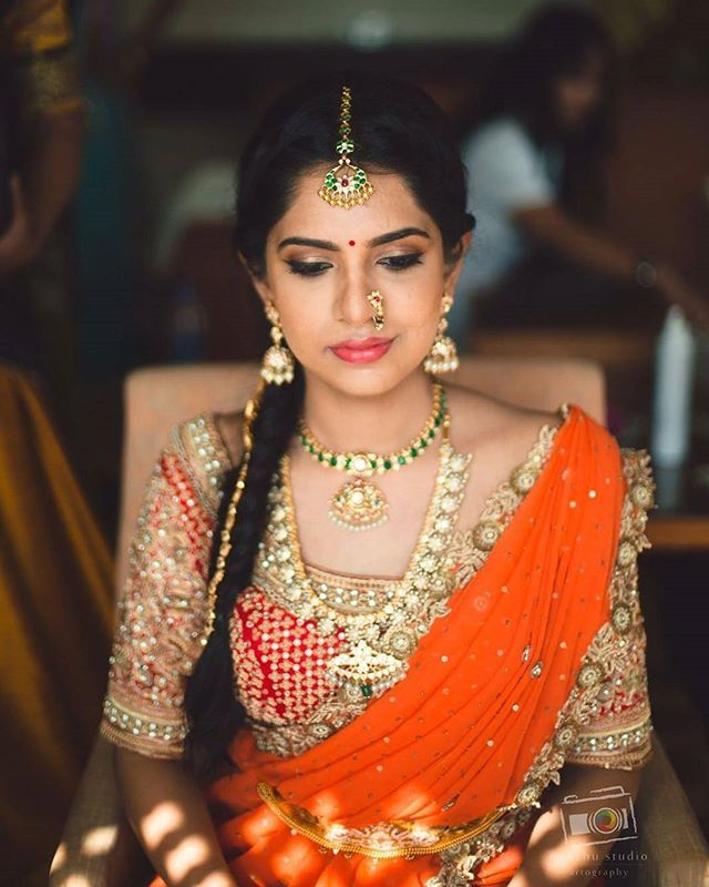 What a beautiful shade of Orange! And that emerald neckpiece just adds to this spectacular look! ❤ PC Minchu Studio @minchustudio Please visit Shopzters.com to read her engagement story!  #indianbride #indiangroom #indianwedding #indianweddinginspiration #indianweddingblog #indianweddingdecor #indianweddingphotography #sareeblouse #silksaree #southindianwedding #southindianbride #bridalwear #bridalblouse #indianweddingwear #weddingwebsite #insta #instalove #instagram #instadaily #shopzters