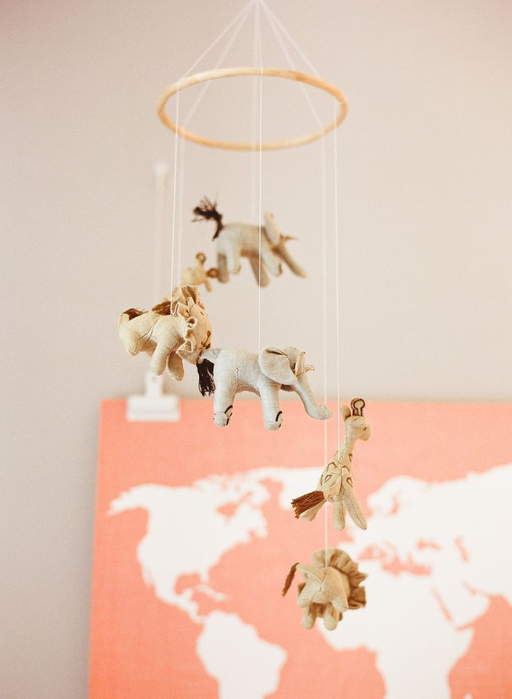 Photography: Jen Rodriguez - www.jen-rodriguez.com  Read More: http://www.stylemepretty.com/living/2015/04/03/a-lovely-travel-themed-nursery/
