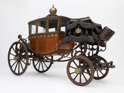 "BRIDAL CAR SISI (""MILANESE CORONATION COACH"") In this magnificent four-passenger Berline, originally a coronation carriage of Napoleon I, Sisi withdrew in 1854 in Vienna as an imperial bride. Painted around 1789/90 in Paris. © Vienna, Kunsthistorisches ..."