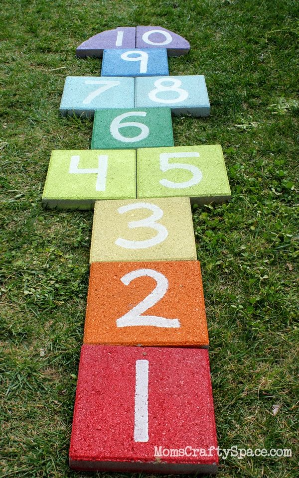 Easy outdoor rainbow hopscotch, use garden pavers and spray paint to add a fun splash of color to your yard.