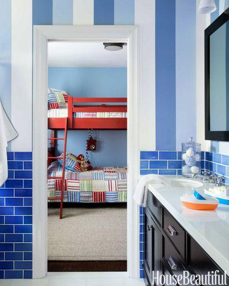 Osborne & Little's Carnaby wallpaper paired with Pratt & Larson tile from Artistic Tile animates the boys' bath.