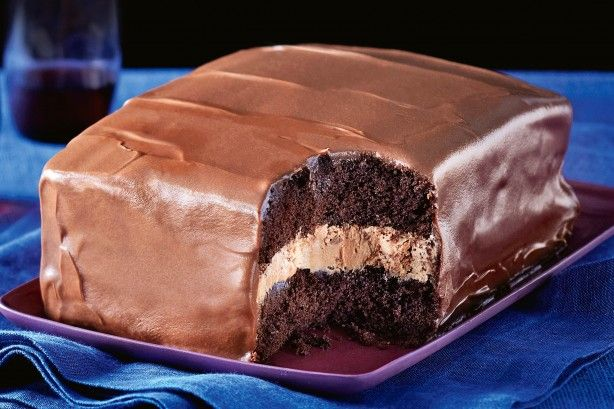 Feast on this – layers of choc cake, fluffy cream filling and rich…