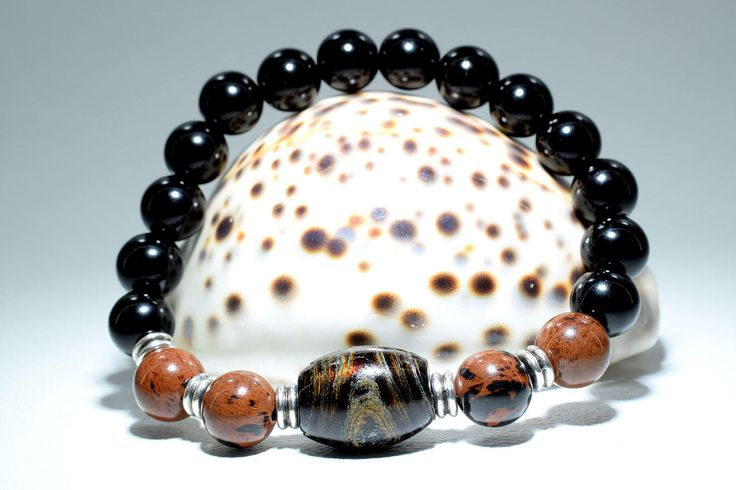 Unique Woman's Bracelet features a large Authentic Black Coral (Yusuri) bead, together with 10 mm Black Onyx and Brown Obsidian beads. Each bead has unique designs and colors that alternate under the appropriate lighting. A handsome piece of Women's Jewelry which attracts the eye! Designed for everyday use. You can wear it to your yoga class, at home or at the office.   #bracelet #beadedbracelet #bohemian