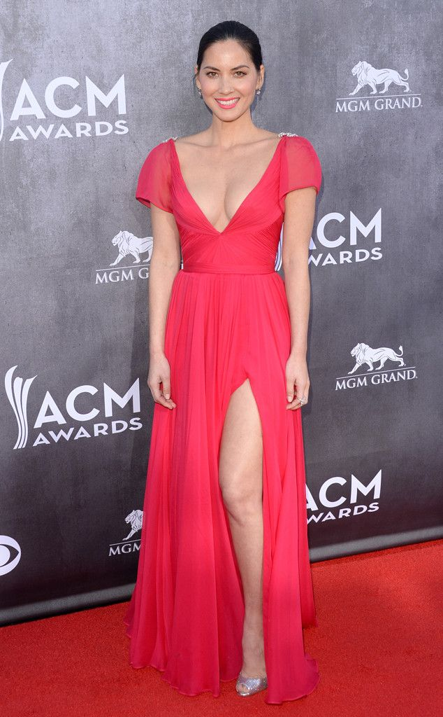 Olivia Munn flaunts lots of skin in a vibrant Rem Acra gown!