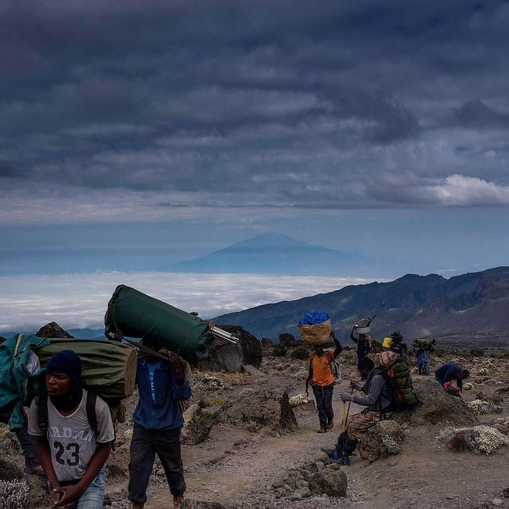 An image of our incredible porters on Kilimanjaro! Couldn't have done it without them! Mount Meru in the background.  #kilimanjaro #mountmeru #africa #Tanzania #treking #trekking #mountains #sunset