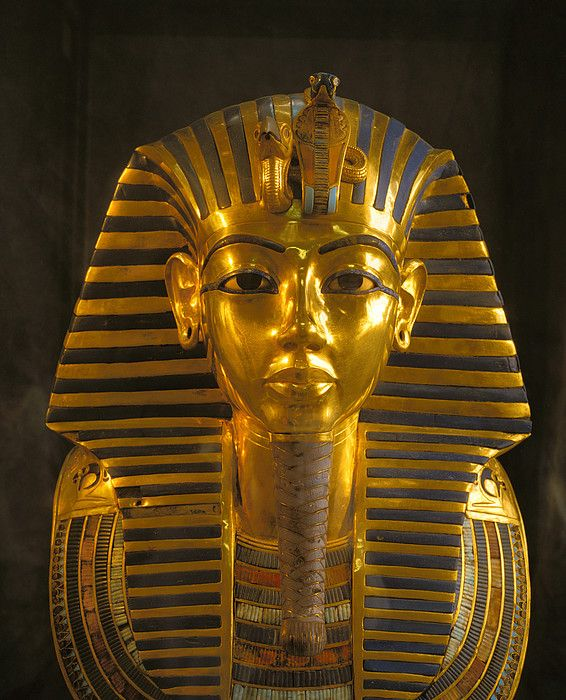 A close view of the gold funerary mask of the pharaoh Tutankhamun.