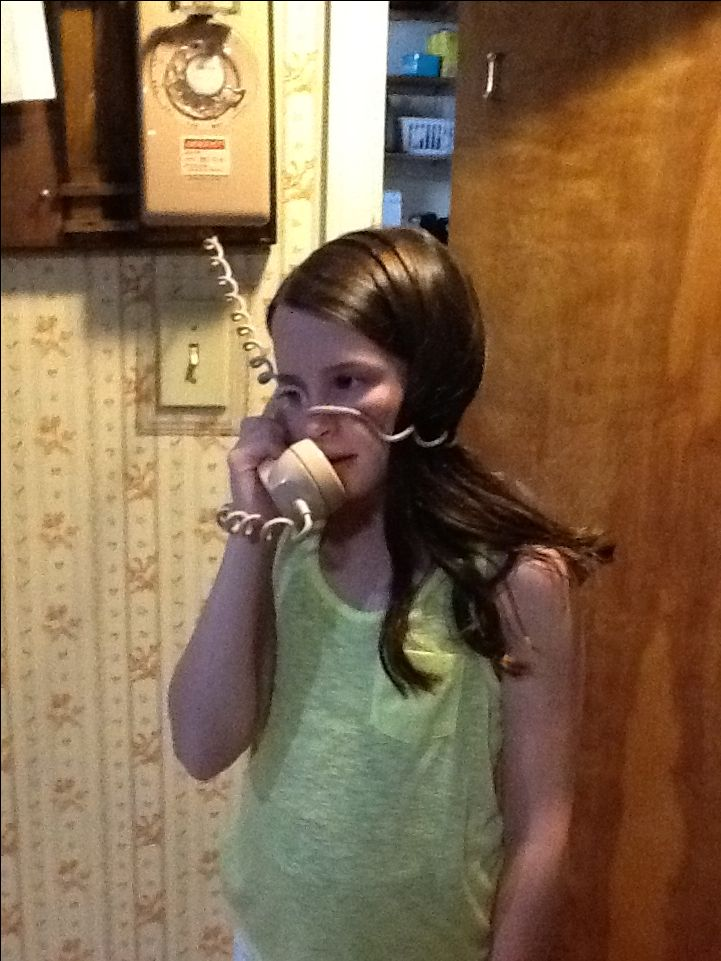 The fun of talking on an old fashioned phone... kids from today will never know.