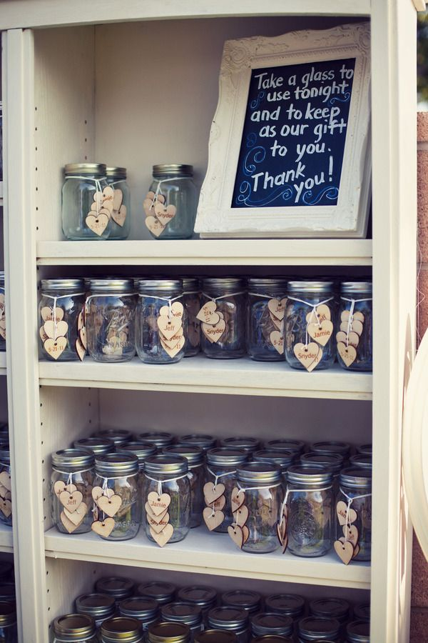 Mason jars as drink glasses for the evening, and they are a simple keepsake that guests can fill at the end of the night with favors of choice (candy, candles, etc.).