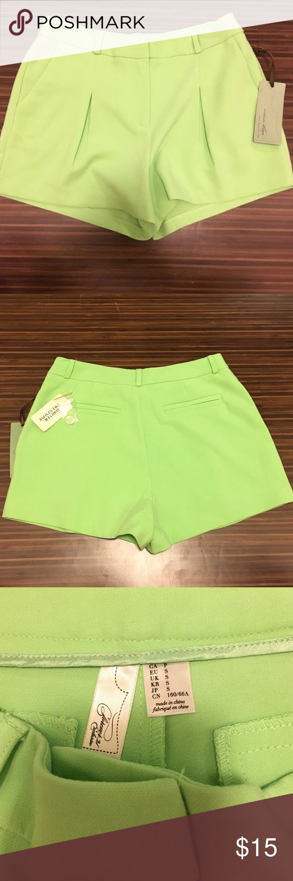 Lime green pleated shorts Like green. Pleated shorts. New with tags. Front and back pockets. Size small. Shorts