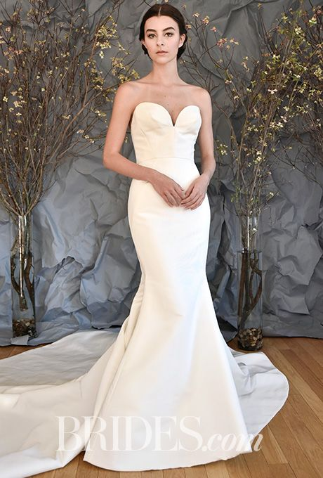 """Brides.com: . """"Prelude,"""" Style AS89, silk faille trumpet gown with plunging neckline and pleated train with covered buttons, Austin Scarlett"""