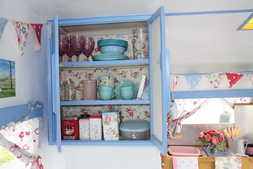papered cupboards....I will be doing this!  Only with my retro wallpaper...