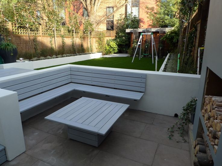 modern sleak garden low maintenance high impact garden design raised white wall beds grey decking east grass lawn turf sunken garden with fire and chimney flat mature trees balham wandsworth london (30)