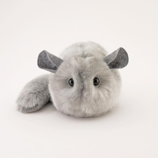 Hi, my name is Comet and I am a Fuzziggle. I have light grey fur and my ears are grey, too. I come in three sizes about 4x6, 5x8, and 6x10 inches, not including my tail. I'm made of plush faux fur and