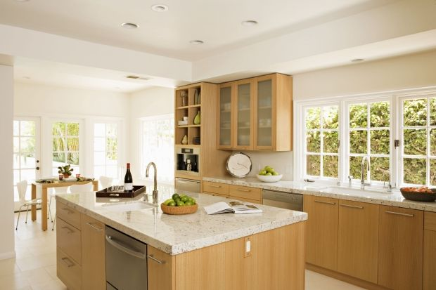 light maple modern kitchen cabinets, white-ish granite counters and limestone floor, white walls and ceiling. Overall light and bright.