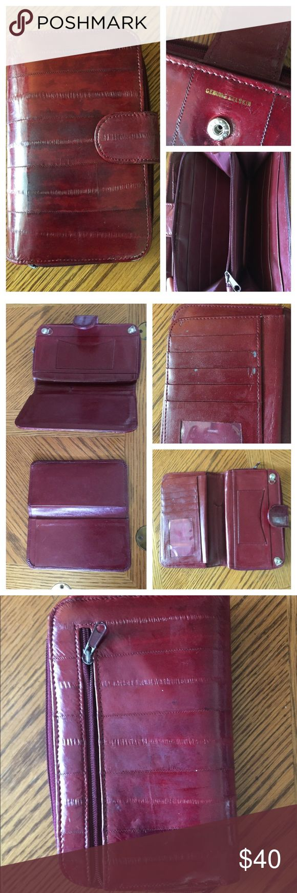 """Vintage Burgundy Eel Skin Clutch Wallet This genuine Eel Skin wallet is in a rich burgundy and is soft as butter.  Compartments galore! Hooks available to attach a chain to make into a cross-body purse. Both sides/inside shown in pics. Measures 7-1/4"""" x  5"""" closed. In wonderful preowned vintage condition showing slight wear on the removable checkbook/credit card/license compartment as shown. Scars, wrinkles, scratches, as well as subtle variations in the color are characteristics of eel skin…"""