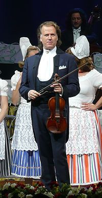 Andre Rieu 2009  André Léon Marie Nicolas Rieu (born 1 October 1949) is a Dutch violinist and conductor best known for creating the waltz-playing Johann Strauss Orchestra. Rieu and the Johann Strauss Orchestra have turned classical and waltz music into a worldwide concert touring music act, as successful as some of the biggest global pop and rock music acts. 17.6. 2014, NCO eCommerce, www.netkaup.is
