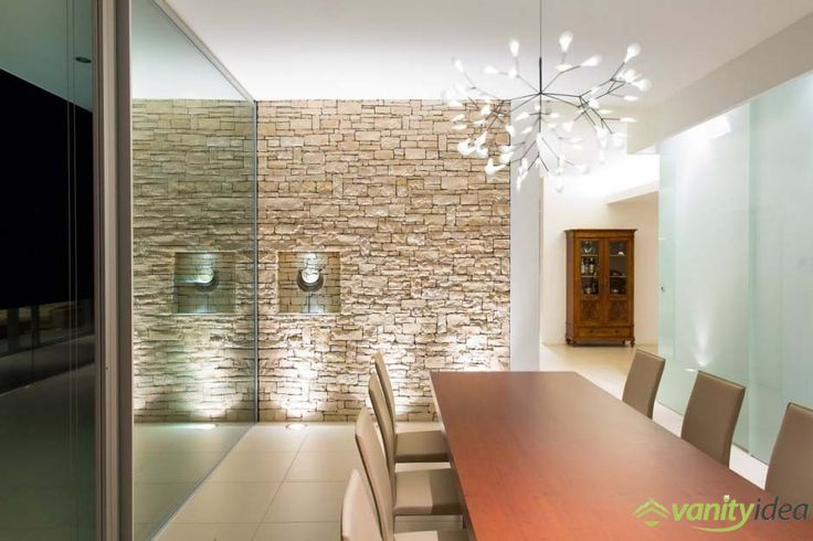 the inside has also a small stone wall that make the room looks modern and chic