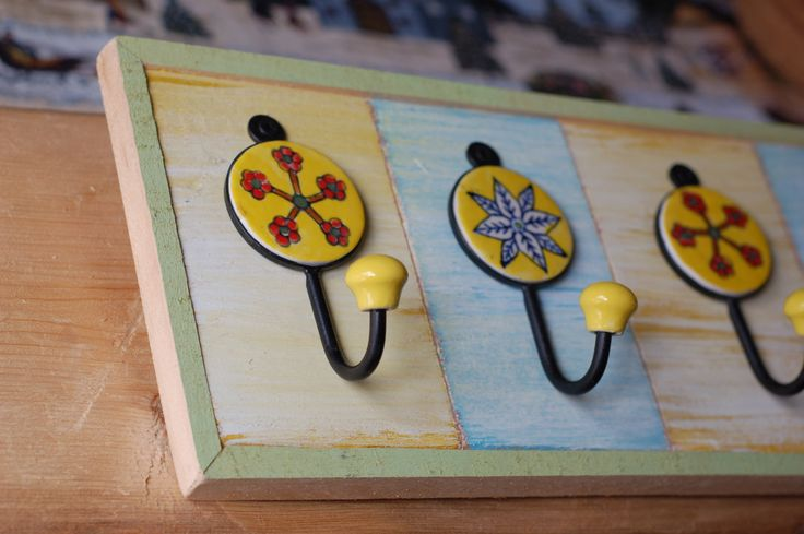 Picture framed accessory rack with ceramic tile hooks.