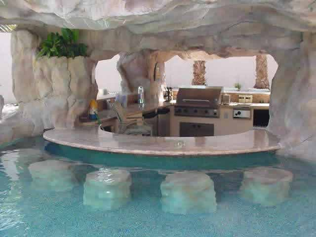 love this...outdoor kitchen connected to the lagoon pool...very hugh hefner.