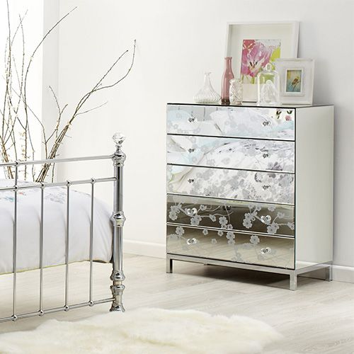 The unique, decorative etched mirror drawer fronts on the bedside tables and tallboy gives your bedroom a stunning.  Pictured: Crystal Five Drawer Tallboy.