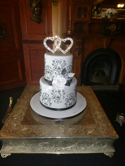 double tier wedding cakes 2 tier barrel wedding cake with stenciling cakes 13709