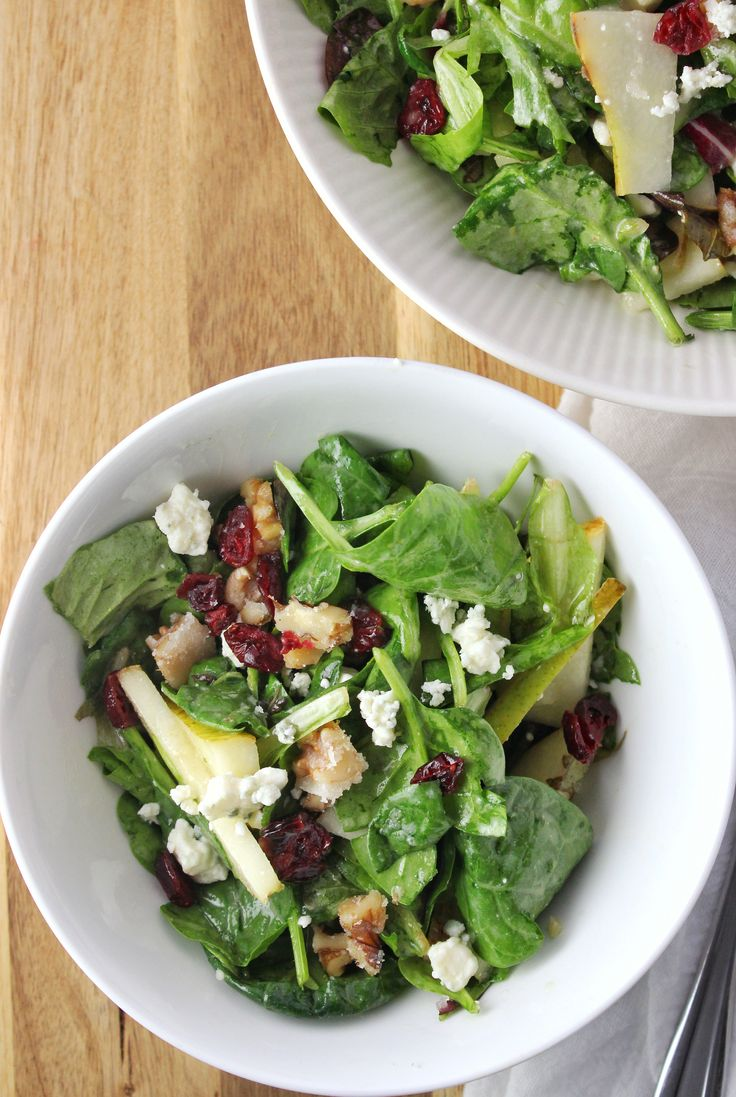 Pear Walnut Blue Cheese Salad - This fresh mixed green salad has candied walnuts, pear, a homemade salad dressing, and topped with a crumble of blue cheese.