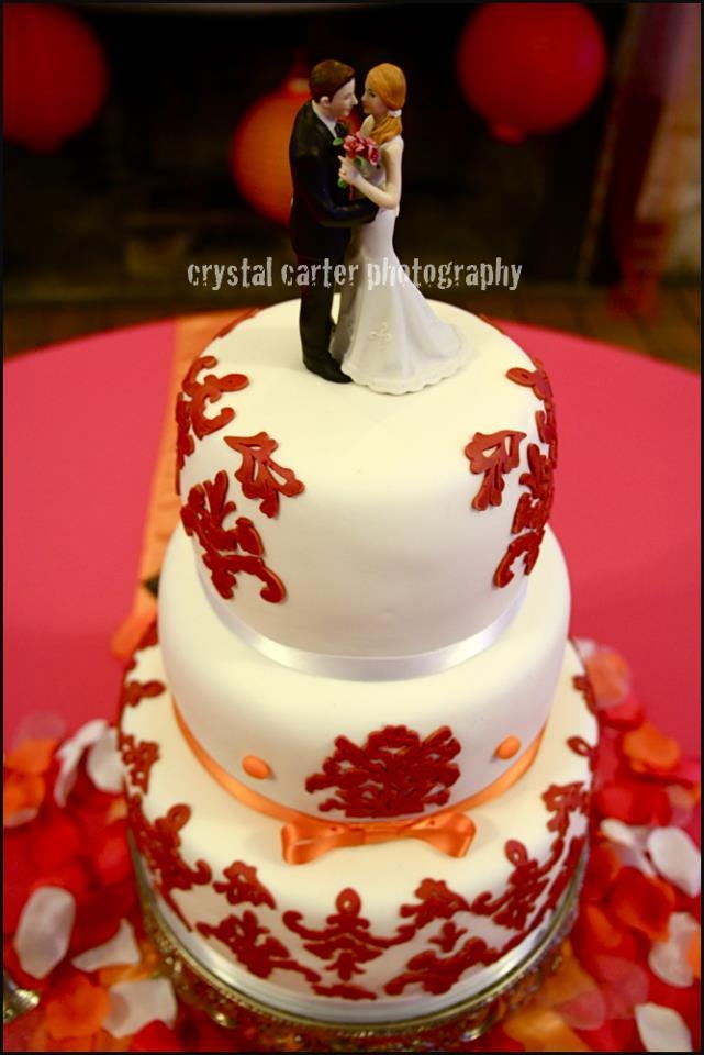 Damask Raspberry and Orange wedding cake :) by KB Kakes in Gainesville, FL.