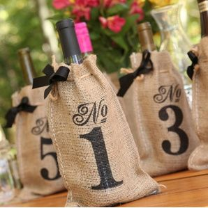 Burlap bottle covers as table numbers! Available at Angelwing Stationers, 6580 Main St. Gloucester, Virginia