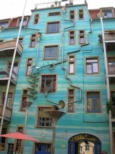 Rube Goldberg's inspired wall in Germany that creates music when it rains, due to the mousetrap drain and gutter system with various sized metal cones. It's called the Funnel Wall at the Kunsthof-Passage in Neustadt.    Oh, I wish I could hear it play!