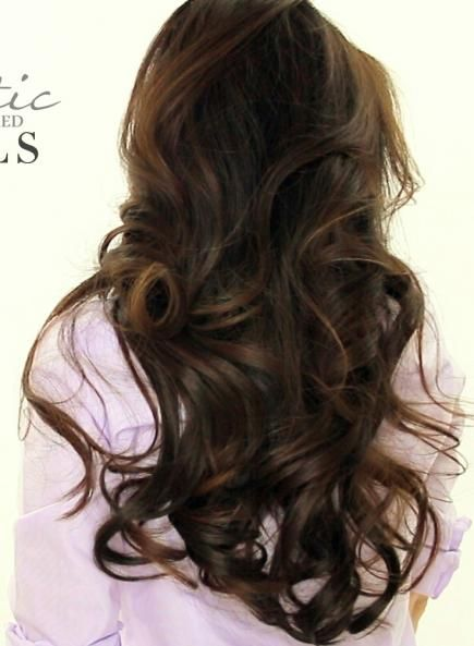 Add a little drama to your bridal look with big, bouncy curls. #WeddingHair #Hairstyles