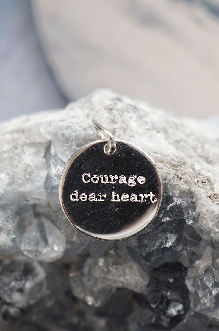 """Tiny minimalist sterling silver round pendants with simple font motivational saying """"Courage dear heart"""""""