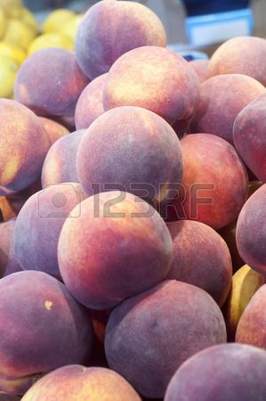 Fresh peaches on display at farmers market.