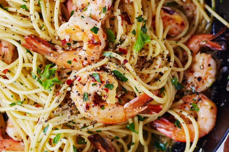 There's just something about shrimp scampi that causes oohs and aahs to break out around the table. Perhaps it's the combination of tender shrimp bathed in a buttery white wine sauce, or maybe it's the way everything gets swirled together with a hearty dash of pepper and fresh torn parsley. For the knowing cook, this is one of the fastest dishes you can make on a weeknight — especially when everything (from the protein to the pasta) comes together in one pot. So invite your friends over…