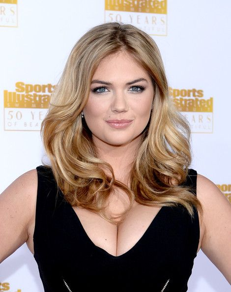 Kate Upton long wavy cut - long bangs, some long layers. Slims her round face and draws attention to the eyes.