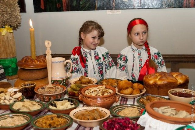 Religion: This is an adorable picture of two little girls on Christmas in the Ukraine. In the picture, you can see all twelve of the dishes that are served to families on Christmas. These dishes are Kutia (wheat), Borsch, Stuffed Fish, Jellied Fish, Perogy (sauerkraut and prunes), Bib (broad beans), Kolacheni Fasoli (beans), Holubtsi (cabbage rolls), Mushrooms, Stewed dried fruit, Kolach, Pampushky. The Christmas celebration is a very important part of the religion in Ukraine.