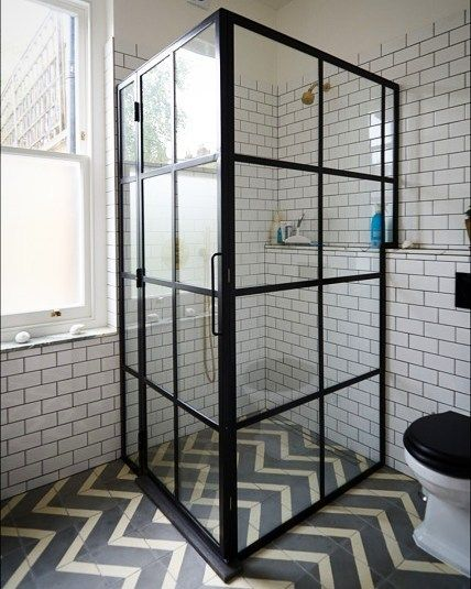 Industrial Style Bathroom. Geometric Zigzag Tiles And A Black Iron Shower  Enclosure Feature In This