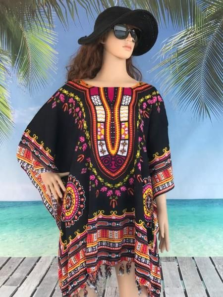Add a touch of majestic glamour to your summer with this stunning plus size tunic top featuring a designer royal yoke print.  Made from a cotton sarong, you will find this long top a cool and comfortable wear.